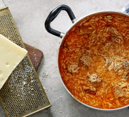 Meat soup with orzo and graviera cheese