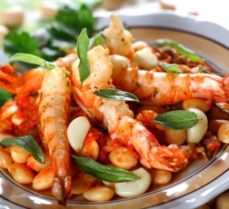 Shrimps with beans and feta with tomato sauce